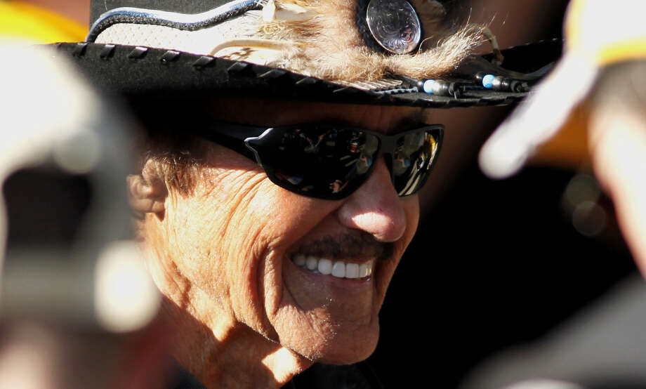 Seven-time NASCAR champion Richard Petty greets fans during an autograph session at Richmond International Raceway in Richmond, Va. The racing legend is riding in the 20 Anniversary Kyle Petty Charity Ride Across America tour, which will make a stop in Beaumont on Wednesday at the Hampton Inn at 3795 Interstate 10 South. (AP Photo/Richmond Times-Dispatch, Bryan Devasher) Photo: Bryan Devasher, MBI / Richmond Times-Dispatch