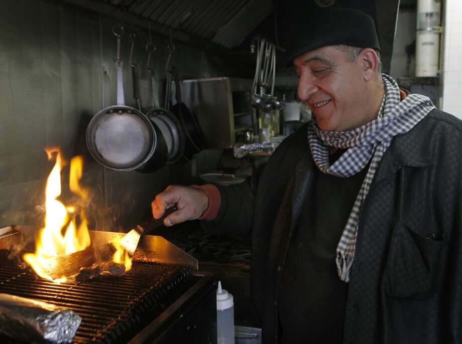 Naime Ayyad cooks a lunch order at his Zaki Kabob House in Albany. Photo: Paul Chinn, The Chronicle