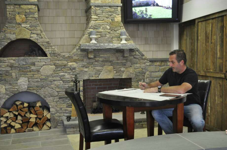 Chris Palmer, owner of Outdoor Design, a Fairfield landscaping firm, has launched Outdoor Design & Living, a Fairfield store focusing on outdoor living products such as outdoor kitchens and appliances, fire pits, pergolas, furniture and lighting. Photo: Contributed Photo., Contributed Photo / Connecticut Post contributed