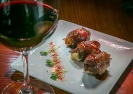 "Dates stuffed with Blue Cheese and Walnuts and a glass of 2010 Le Piane ""Mimnio"" Vino Rosso at the Barrel Room in Oakland, Calif., is seen on Wednesday, April 30th, 2014."