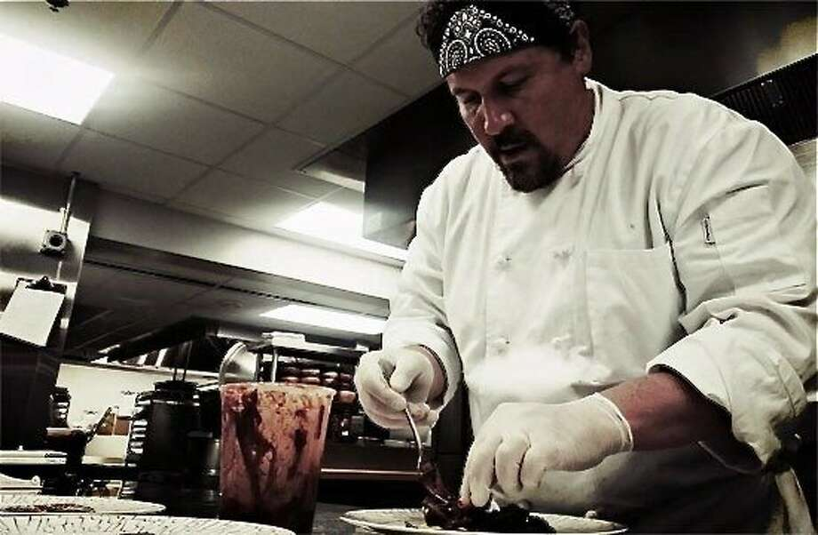 """In """"Chef,"""" Jon Favreau plays a masterful cook who loses his restaurant job and starts a food-truck business so he can do things his way. The movie opens Friday at Bay Area theaters. Photo: Open Road Films"""