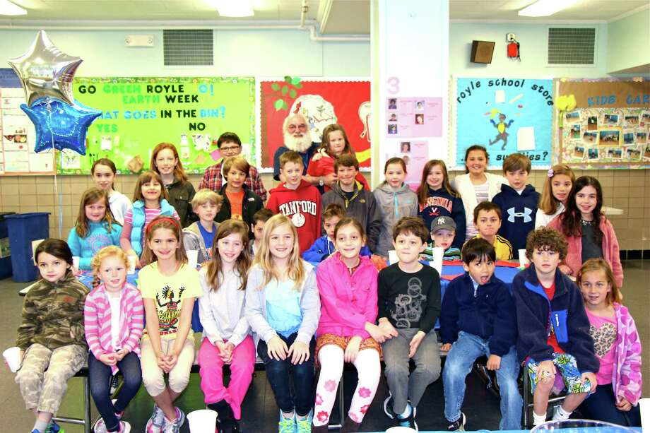 "To kick off Royle Elementary School's Book Fair week, raffle winners from each grade attended a special breakfast and an exclusive preview of the selections. This year's book fair theme, ""Royle's Full of Characters"" is a celebration of the illustrations that bring a story to life. Royle custodian Roy Jobst, in back, was the special guest at the breakfast. The children shared doughnuts, fruit and juice with the man who has worked in Darien Public Schools for almost 11 years. Photo: Contributed Photo, Contributed / Darien News"