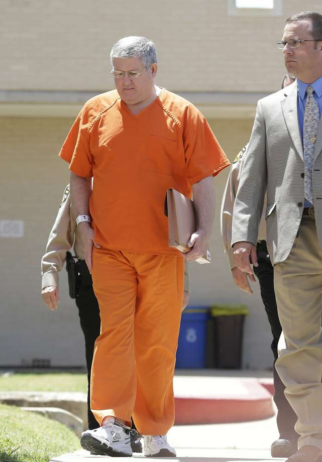 Bernie Tiede is led into the Panola County court house by law enforcement officials in Carthage, Texas, Tuesday, May 6, 2014. The former mortician serving a life sentence for the death of a rich East Texas woman could soon go free with the agreement of the district attorney who prosecuted him. Tiede, whose case inspired the Matthew McConaughey movie ?Bernie,? is expected in court in Carthage, Texas. (AP Photo/LM Otero) Photo: LM Otero, Associated Press