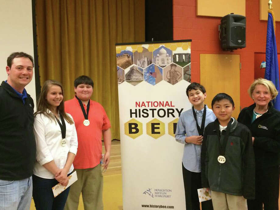 Middlesex Middle School had four students compete in the regional finals of the National History Bee in Bridgeport April 16. They are Evan Tong, grade 7; Griffin Samroengraja, grade 7; Casey Martin, grade 8; and John Phipps, grade 6. All four students finished in the final top 10 with high scores that now qualify them to compete at the National History Bee competition in June in Atlanta. Tong finished second overall and Samroengraja tied for third place. From left, coach Ken Romeo, Martin, Phipps, Samroengraja, Tong and coach Barbara Ivey. Photo: Contributed Photo, Contributed / Darien News