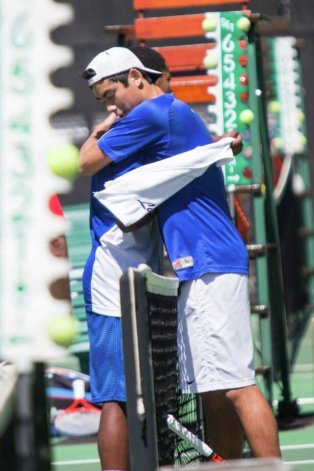 Katy Taylor High School's Peter Leung, front, hugged Northside Jay High School's Gabriel Evans after winning the final game of their match. Photo: Andrew Buckley, MBR / Conroe Courier