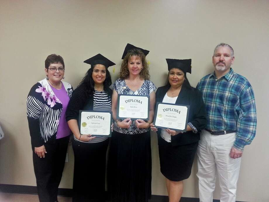 Assistant Director of Food Services Terry Neinast, left, congratulates the academy graduates Sylvia Cruz, Beth Rios and Priscilla Chapa with Food Services Director Matt Antignolo. Photo: Lamar CISD