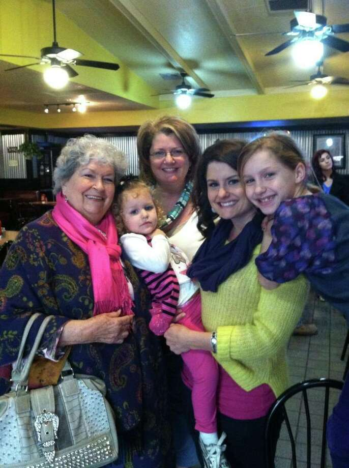 """This is a photo of me, my two daughters, my mother and my grandmother - 4 generations of Miller look-a-like ladies."" - Amy Moore"