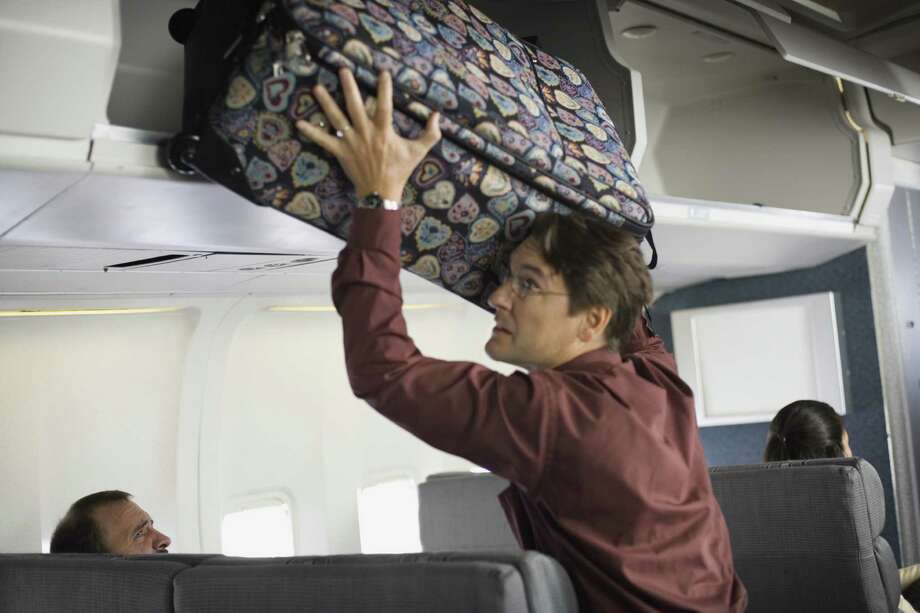 What's worse: Travelers who misuse overhead bins on a plane, or people who recline their seats in the coach section?   65 percent chose misuse of overhead bins as the worst annoyance, while 35 percent hate having a seat reclined back into their faces. Photo: Jupiterimages, Getty Images / (c) Jupiterimages