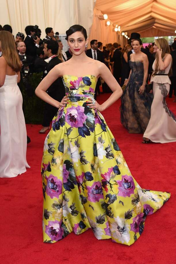 Best:Looking stunning in Carolina Herrera, Emmy Rossum proves that it's possible to wear a bold floral gown without looking like upholstery. Photo: Larry Busacca, Getty Images