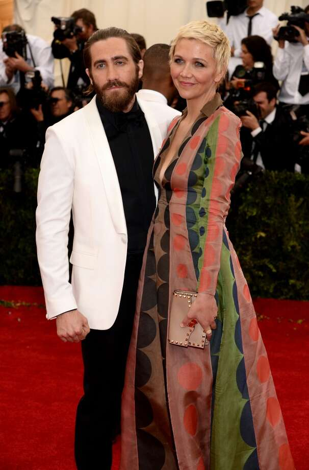 Worst: Sibling fashion gone wrong. Maggie Gyllenhaal's Valentino gown looks like wallpaper from the '70s, and Jake really, really needs to shave that beard. Photo: Dimitrios Kambouris, Getty Images