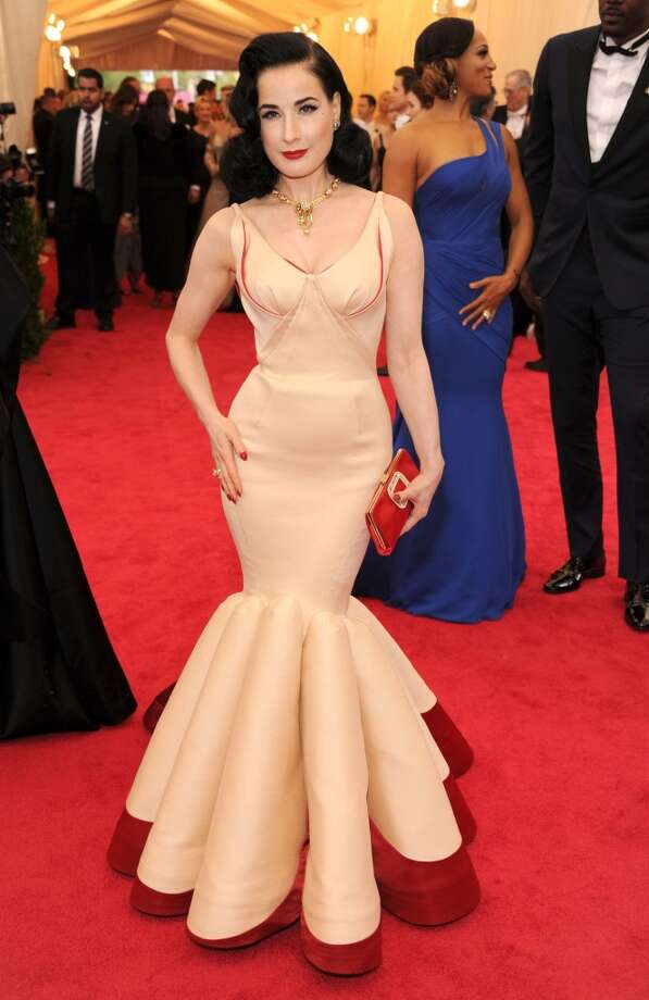 Best: Burlesque star Dita Von Teese always looks glamourous, and she continues that trend in this flesh-colored, lingere-inspired Zac Posen gown. We love the red accents and the way the mermaid cut accents her figure. Photo: Kevin Mazur, WireImage