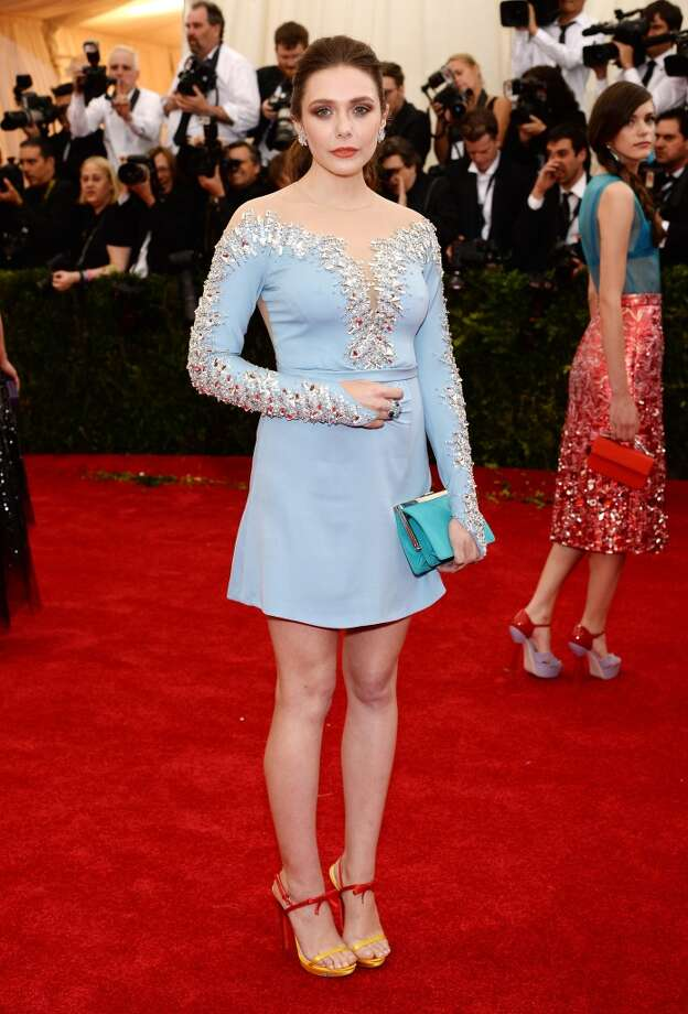 Worst:Elizabeth Olsen's short Miu Miu dress feels more appropriate for an ice skating performance than the Met Gala. And what's up with the clutch and shoes? Photo: Dimitrios Kambouris, Getty Images