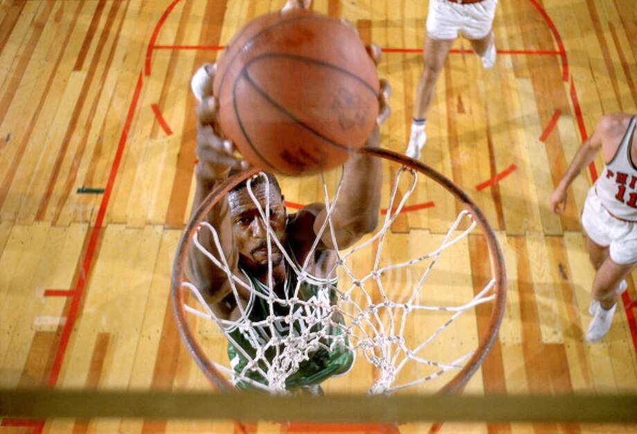 1960-61 — Bill Russell, Boston Photo: John G. Zimmerman, Sports Illustrated/Getty Images / 1961 Sports Illustrated