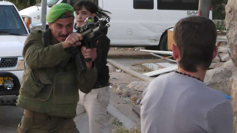 Loses his cool: An AP-authenticated image taken from video obtained from Youth Against Settlements shows