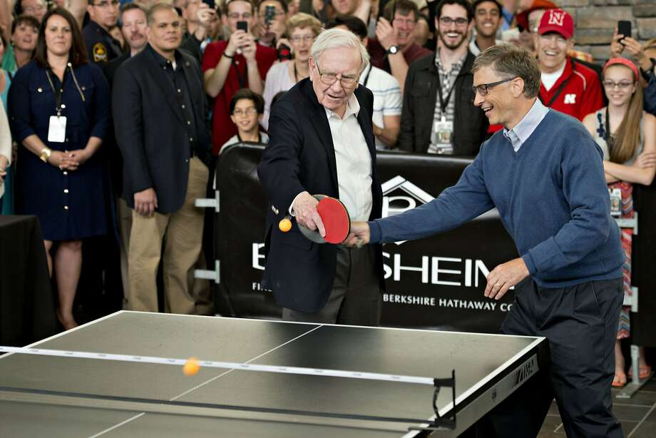 Now take turns, boys: Warren Buffett and Bill Gates, the world's richest ping-pong doubles team, swing at the same ball during a Berkshire Hathaway shareholders meeting in Omaha. Photo: Daniel Acker, Bloomberg