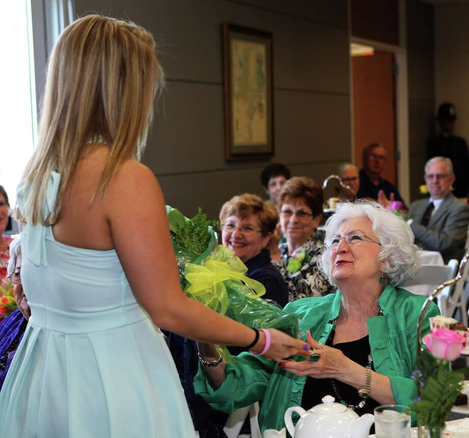ACC Regent Brenda Brown, right, receives yellow roses during the President's Tea on April 29 in recognition of her time on the college board. Photo: Alvin Community College