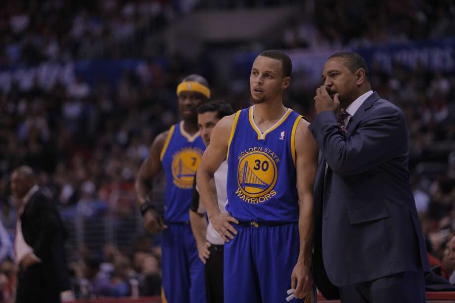 Stephen Curry (30) and head coach Mark Jackson talk during a timeout in the first half. The Golden State Warriors played the Los Angeles Clippers at Staples Center in Los Angeles, Calif., in Game 5 of the first round NBA Playoffs on Tuesday, April 29, 2014. Photo: Carlos Avila Gonzalez, The Chronicle