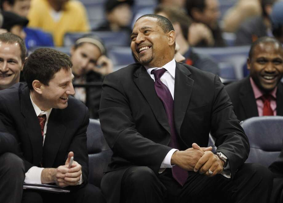 Golden State Warriors head coach Mark Jackson, right, and then-assistant coach Darren Erman share a lighthearted moment while playing against the Memphis Grizzlies during an NBA basketball game Saturday, Dec. 7, 2013, in Memphis, Tenn. Photo: Lance Murphey, ASSOCIATED PRESS
