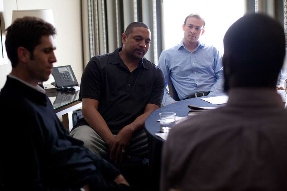 Golden State Warriors head coach Mark Jackson (center) looks as his notes as he questions a prospect during a roundtable interview with team executives during the NBA draft combine in Chicago on Thursday, June 7, 2012. Photo: Jeff Cagle, Special To The Chronicle