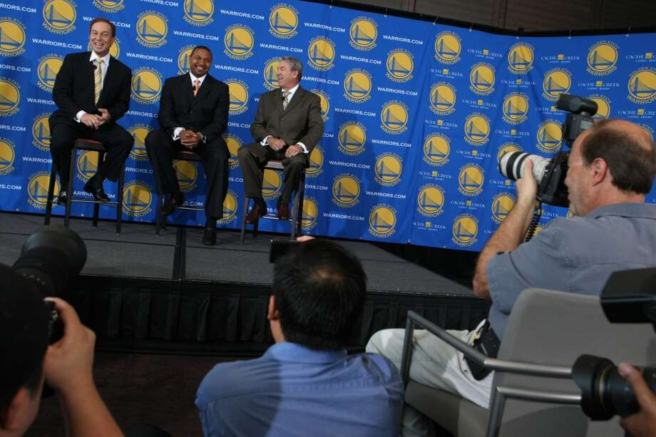 File photo: Joe Lacob, the Golden State Warriors team owner, left, and Warriors General Manager, Larry Riley, right, introduce their new Head Coach, Mark Jackson, middle, during a press conference at the St. Regis Hotel in San Francisco, CA Friday, June 10, 2011. Photo: Erin Lubin, Special To The Chronicle