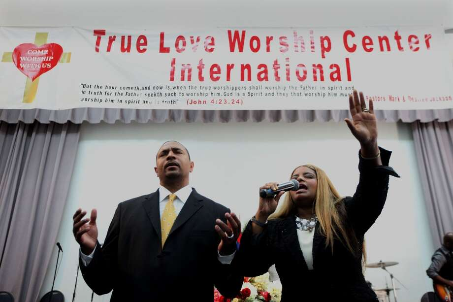 Pastor Mark and Desiree Jackson lead a prayer during a worship service at the True Love Worship Center in Van Nuys, CA on Sunday, July 31, 2011. Photo: Sandy Huffaker, San Francsico Chronicle