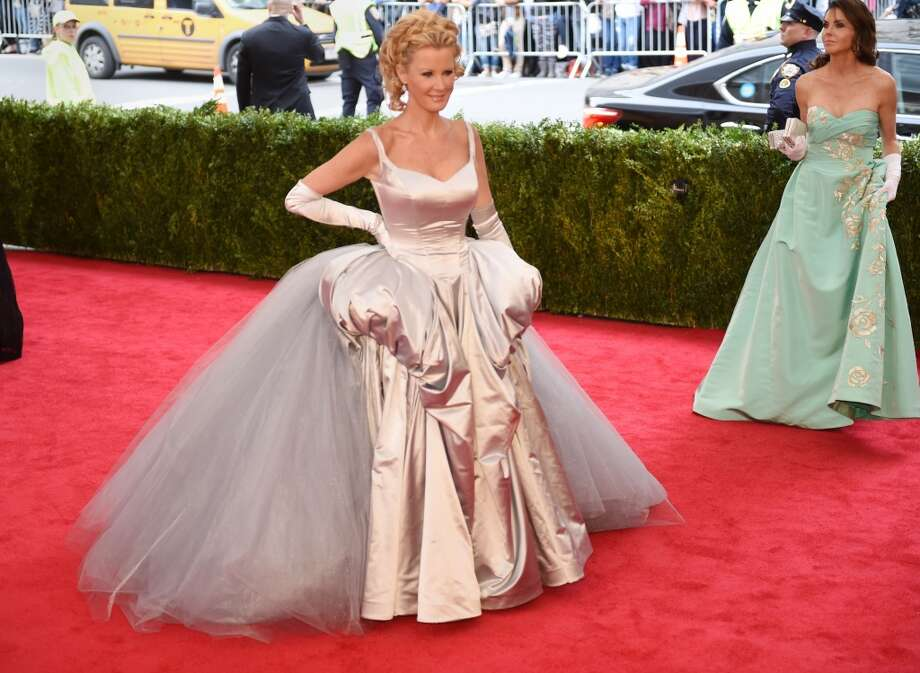 Worst:The hair, the fabric, the matching gloves, the silhouette. There's no way to put this nicely: Sandra Lee's look is all kinds of bad. Photo: TIMOTHY A. CLARY, AFP/Getty Images