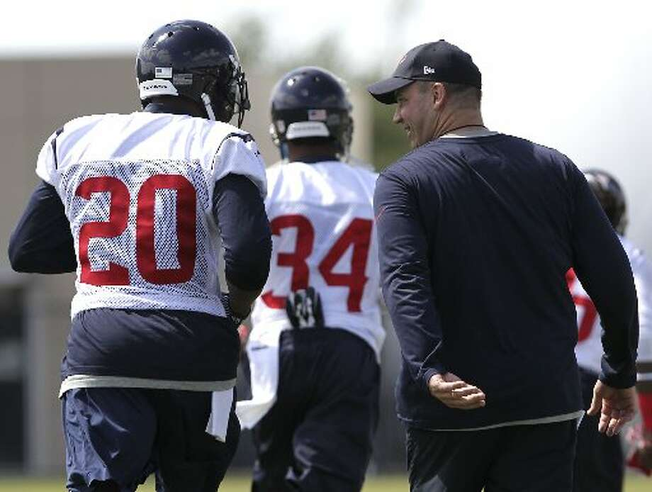 Bill O'Brien, right, speaks with safety Chris Clemons. Photo: James Nielsen, Houston Chronicle