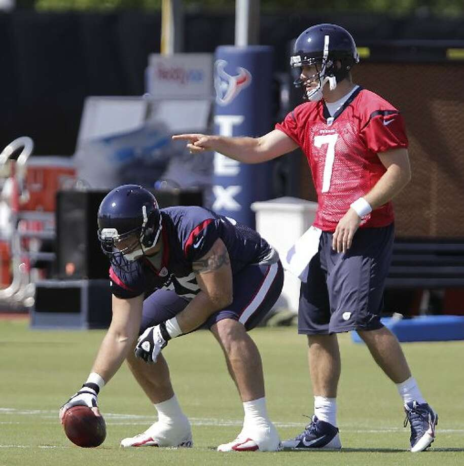 Case Keenum, right, calls out a play. Photo: James Nielsen, Houston Chronicle