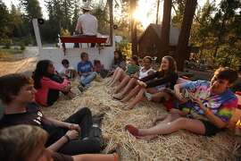 Camp Mather campers enjoy a hayride excursion at Camp Mather on Wednesday, July 30, 2009. Mather Saddle and Pack Station owner, Jay Barnes says he's seen a downturn in ride participants because of the economic slump. Camp Mather, which until now has always been booked solid and is the coveted summer prize for families year after year, has seen a dip in attendance from a downturn in the economy. Mather is a San Francisco institution. It is a tradition for many, many families and is one of the few affordable getaways for city kids and middle class families.