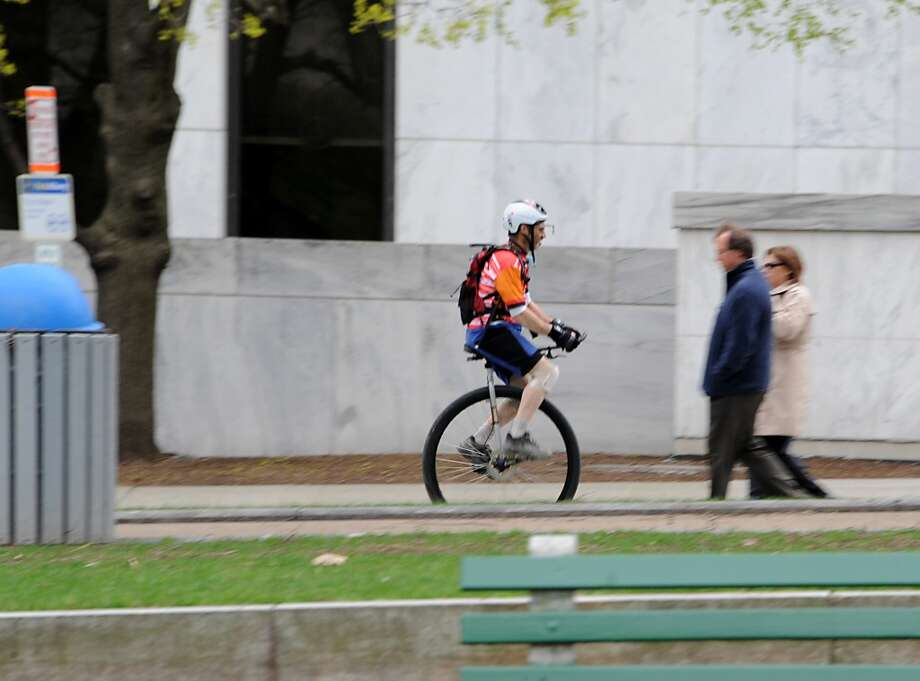 A man rides a unicycle up State St. near the Legislative Office Building on Tuesday May 6, 2014 in Albany, N.Y.  (Lori Van Buren / Times Union) Photo: Lori Van Buren, Albany Times Union