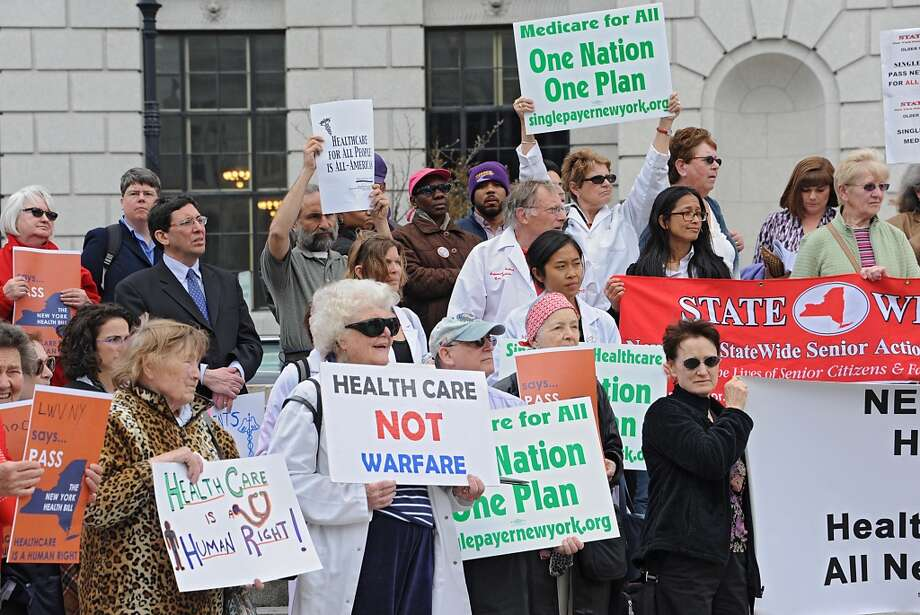 People participate in a rally in support of the New York Health bill, which creates a universal, single-payer health insurance program outside the Capitol on Tuesday May 6, 2014 in Albany, N.Y.  (Lori Van Buren / Times Union) Photo: Lori Van Buren, Albany Times Union