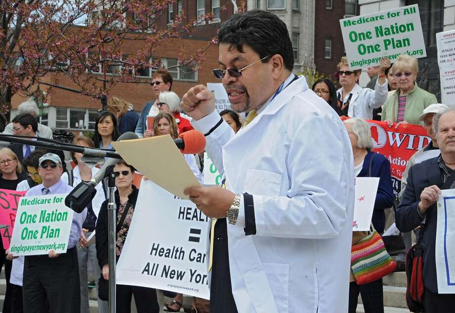 Matthews Hurley, MD, Executive Director, Doctors Council SEIU, speaks during a rally in support of the New York Health bill, which creates a universal, single-payer health insurance program outside the Capitol on Tuesday May 6, 2014 in Albany, N.Y.  (Lori Van Buren / Times Union) Photo: Lori Van Buren, Albany Times Union