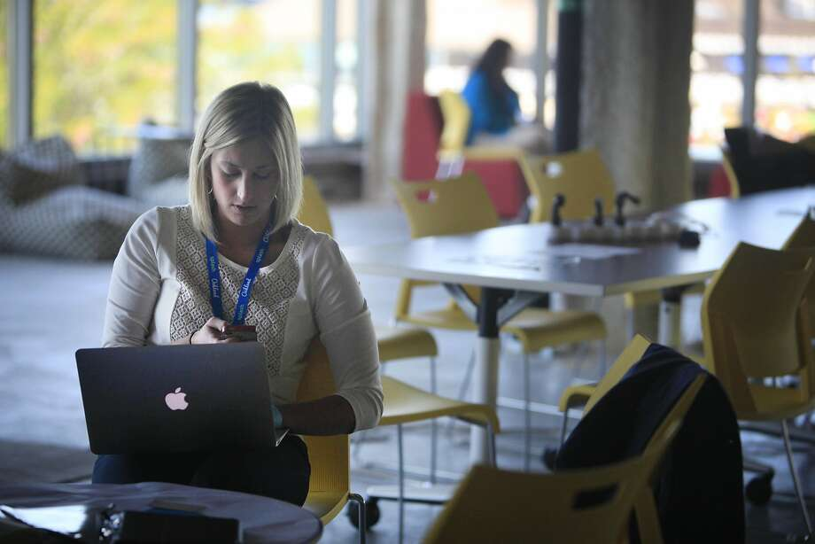 Brittany Burgess of Launch Tennessee works in an office set up by co-working space company Port at the Vator Splash conference. Photo: Lea Suzuki, The Chronicle