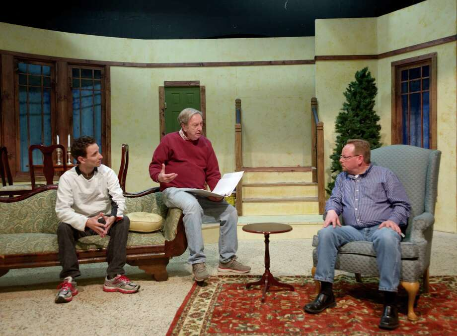 "Chesley Plemmons, center, the director of ""The Last Night of Ballyhoo,"" by Alfred Uhry, talks on stage with two of his actors, Charles Roth, left, who plays Joe Farkas in the play, and Steven Ross, who plays Adolph Freitag. The play is being presented by TheatreWorks New Milford, in New Milford, Conn., through May 24. Photo: H John Voorhees III / The News-Times Freelance"