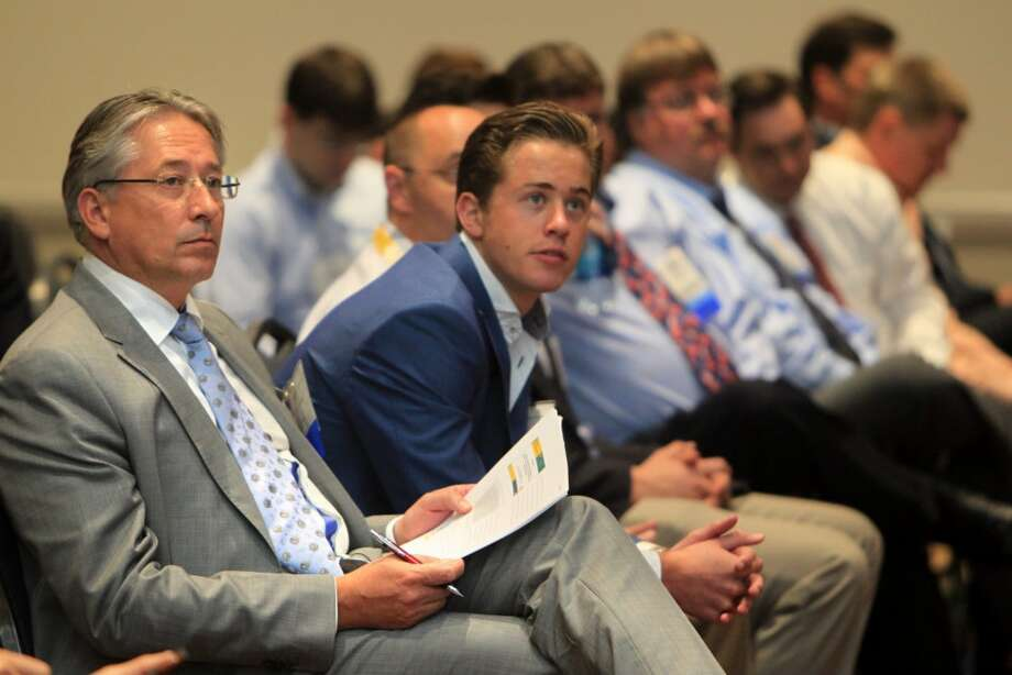 (Left) Arno Van Den Haak waits to deliver remarks in the Mars B Development panel during the Offshore Technology Conference at NRG Park on May 5, 2014, in Houston, Tx. ( Mayra Beltran / Houston Chronicle )