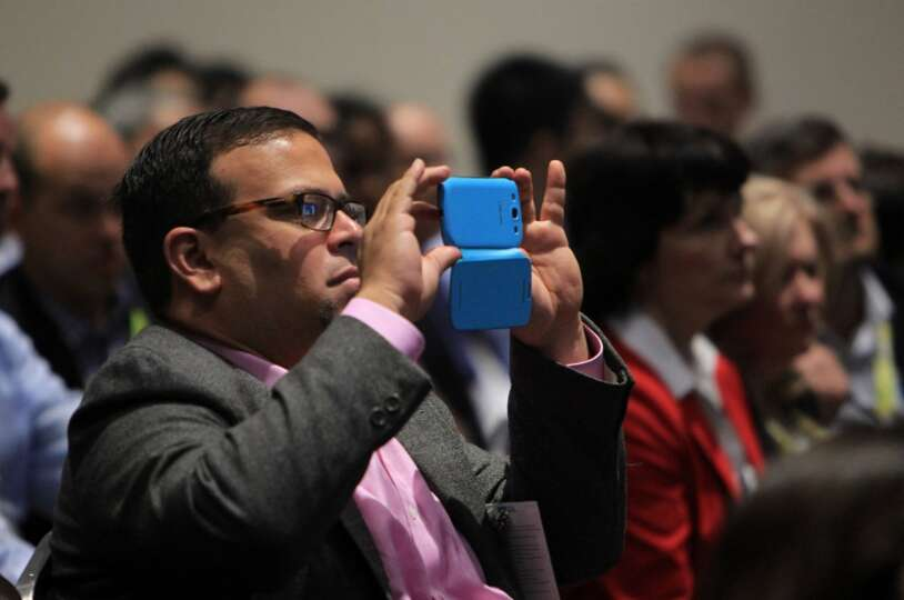 A member of the audience photographs speakers in the Shell's Mars B Panel during the Offshore Techno