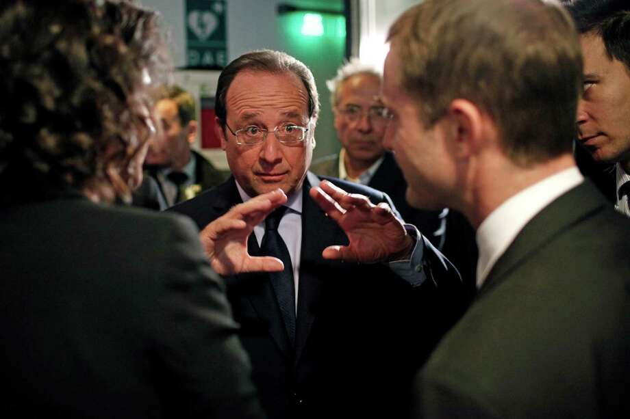 France's President Francois Hollande, center, gestures as he talks to the media after an interview with BFM television journalist in Paris, Tuesday, May 6, 2014. (AP Photo/Thibault Camus, Pool) Photo: Thibault Camus, Associated Press / Associated Press contributed