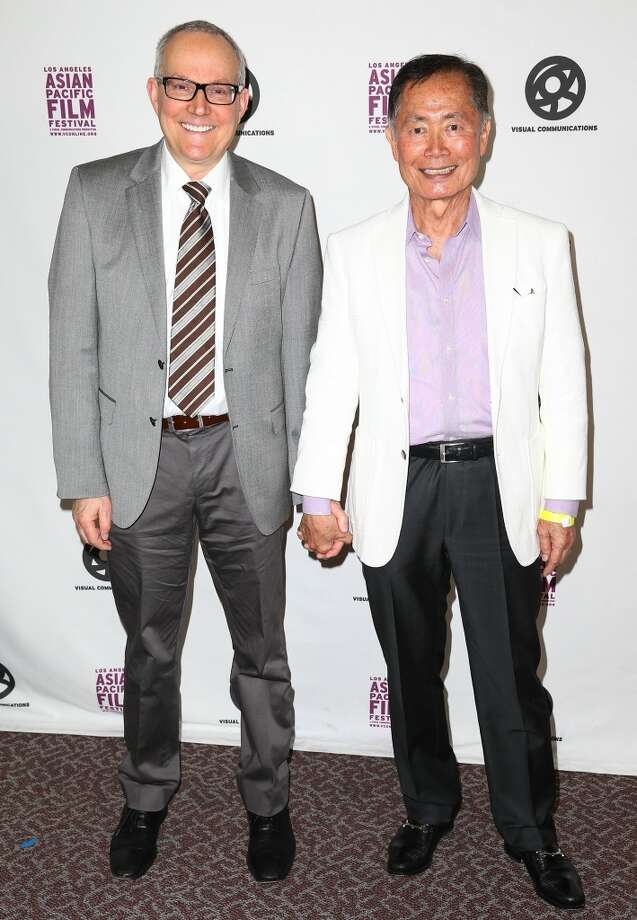 Actor George Takei (right) and his partner, Brad Takei, have become a beloved public couple since Takei publicly came out in 2005. The pair have been together over 30 years and are active in several Japanese American (Takei is an internment activist), LGBT and elder advocacy groups. Photo: Imeh Akpanudosen, Getty Images