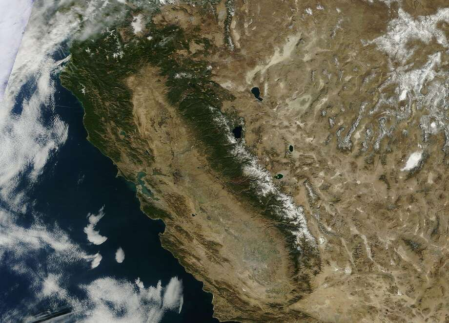 Jan. 18, 2014: A Terra satellite image shows a dry, brown California with little snow in the Sierra. Photo: NASA