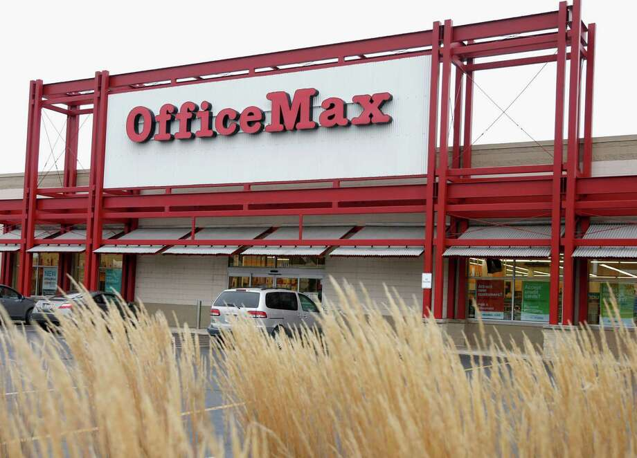 FILE - This Nov. 1, 2013 file photo shows the exterior of an Office Max store in Chicago. Office Depot is planning to close at least 400 U.S. stores, as its merger with OfficeMax resulted in an overlap of retail locations that can be consolidated. The office supply retailer had 1,900 stores in the U.S. at the end of the first quarter, so the plans call for closing about 21 percent of them. Office Depot and OfficeMax Inc. completed their $1.2 billion deal last November. (AP Photo/Charles Rex Arbogast, File) ORG XMIT: NYBZ195 Photo: Charles Rex Arbogast / AP