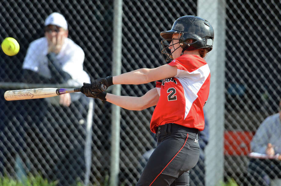 New Canaan's Molly Keshin connects with the ball during the softball game against Staples High School in Westport on Tuesday, May 6, 2014. Photo: Amy Mortensen / Connecticut Post Freelance