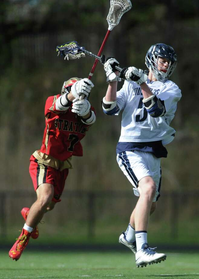 Immaculate's Will Hatcher (5) shoots past Stratford defender Jake Cayton (7) in the high school boys lacrosse game between Immaculate and Stratford at Immaculate High School in Danbury, Conn. Tuesday, May 6, 2014. Photo: Tyler Sizemore / The News-Times