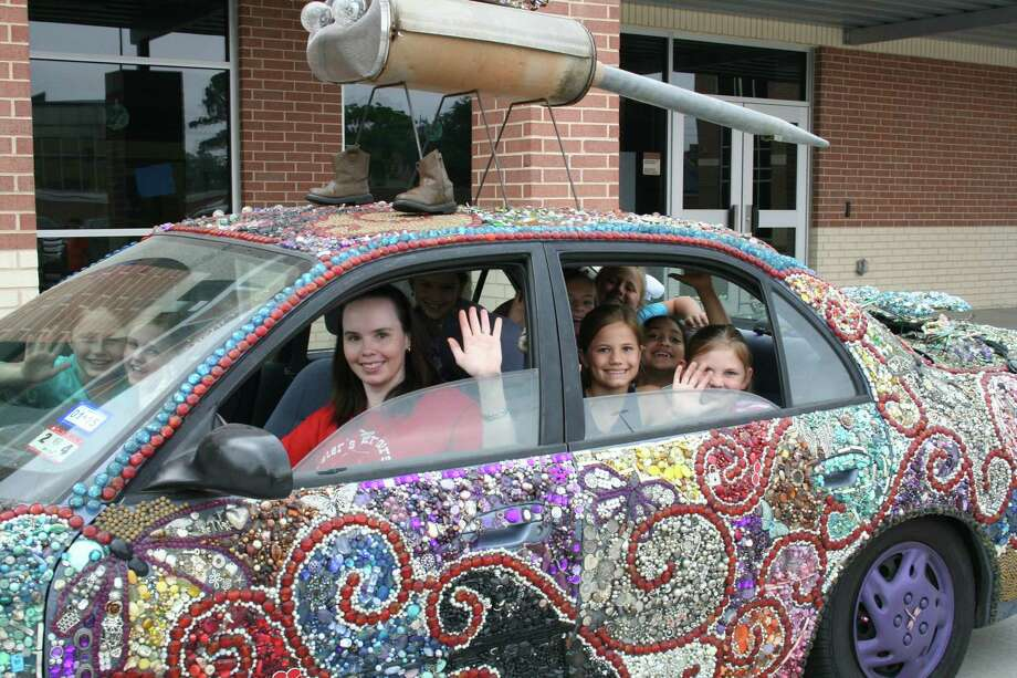 Third-grade students at Wilchester Elementary School are eager for crowds to see their car at  Houston's Art Car Parade. With teacher Stephanie Walton at the wheel,  students Eliana Murphey and Sarah White, front seat, and Paige Dial, Ava Johnson, Lauren Boem, Claire Shea-han, Lana Colburn and Meredith Piercy are ready for a ride. Photo: Tom Behrens