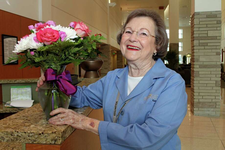 Patsy Williams, a 14-year volunteer at Memorial Hermann Katy Hospital, prepares to deliver flowers to a patient on the second floor. Photo: Suzanne Rehak, Freelance Photographer