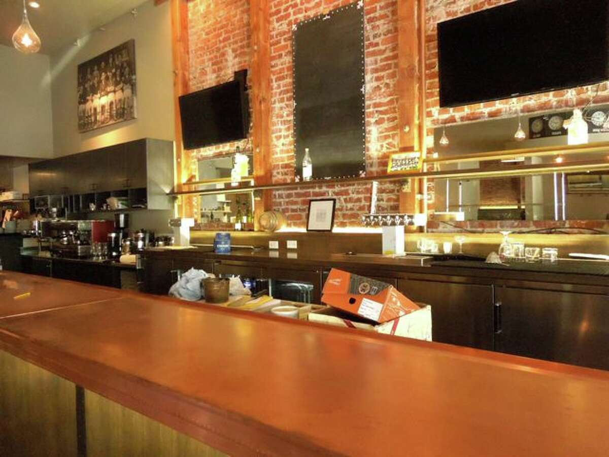 The new, full, copper clad liquor and raw bar / Photos SF Chronicle