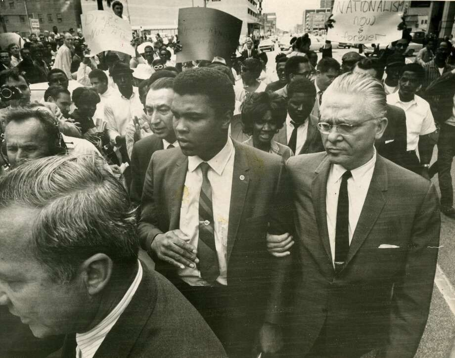 Muhammad Ali leaves Houston's Armed forces induction center after refusing to be inducted into armed forces, April 28, 1967.  Photo: David Nance, Houston Chronicle