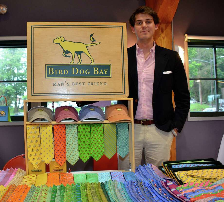 Zak Workman with colorful Bird Dog Bay ties and hats, at the Outback's 2013 Red Geranium Boutique. This year's event, slated for May 20, will include 15 vendors. Photo: Jeanna Petersen Shepard / New Canaan News Freelance