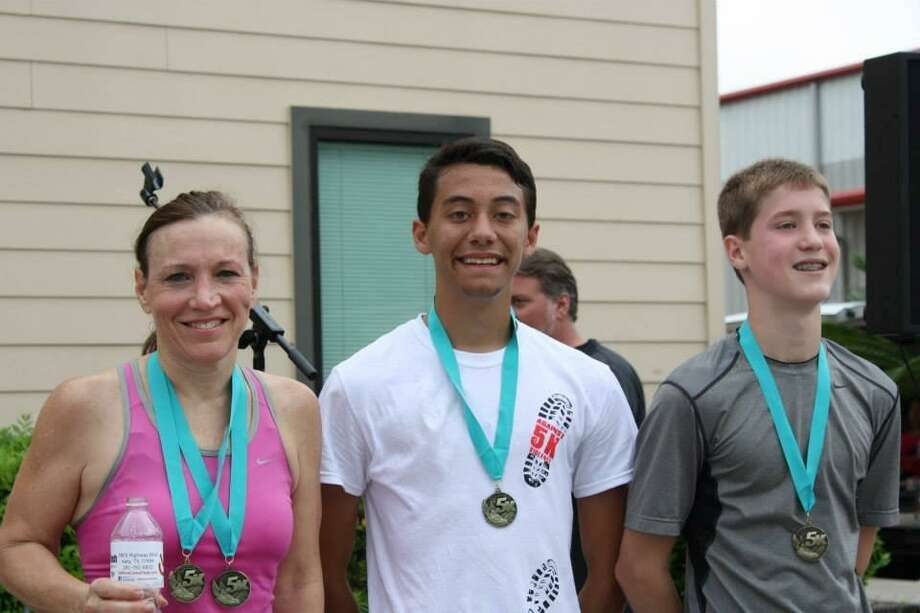 Winners of the Katy Christian Ministries 5K run are: Louisa Sykes, left, second place; Ryan Tagle, third place; and Cameron Patterson, first place.