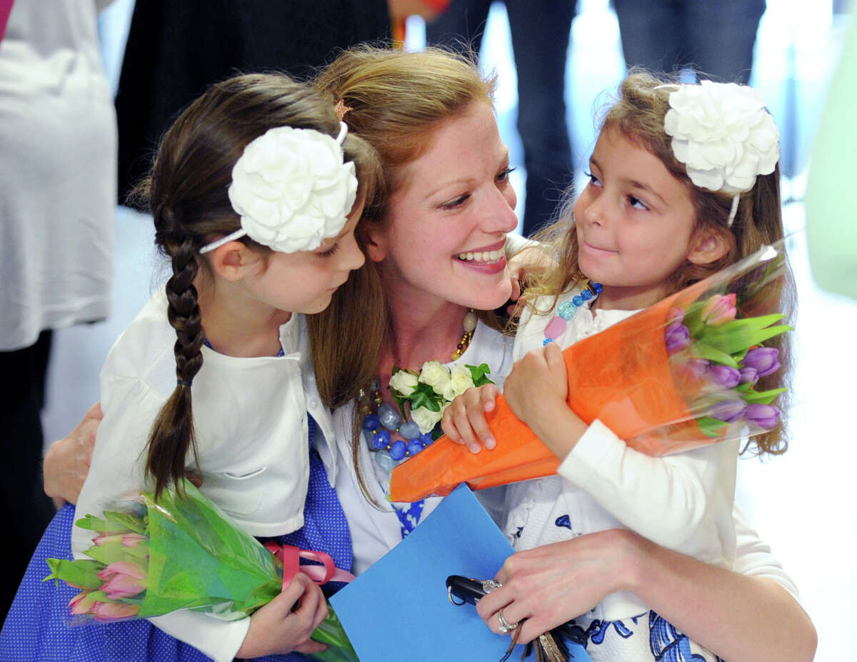 Greenwich Public Schools Distinguished Teachers award winner, Sheri McGowan, left, a Riverside School first grade teacher, with her daughters, Lorelei, 6, left, and Lilliana,4, prior to the ceremony at Central Middle School in Greenwich, Tuesday, May, 6, 2014.