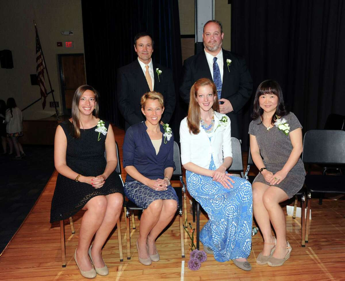 The Greenwich Public Schools Distinguished Teachers award winners top row, left to right, James Micik, Robert Walsh, bottom row, left to right, Mara Adelsberg, Cheryl Iozzo, Sheri McGowan and Lin Yuan Young during the ceremony at Central Middle School in Greenwich, Tuesday, May, 6, 2014.